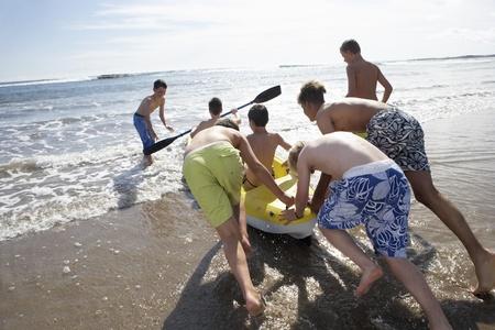 Teenage boys kayaking photo