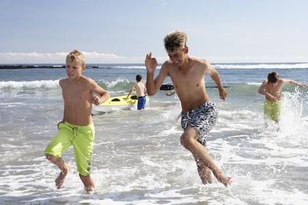 Teenagers playing on beach photo