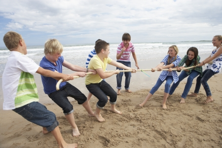 Teenagers playing tug of war photo