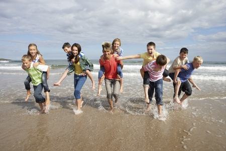 Teenagers playing piggyback Stock Photo