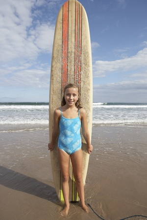 swimming costumes: Girl with surfboard