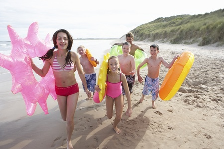 rubber ring: Teenagers on beach Stock Photo