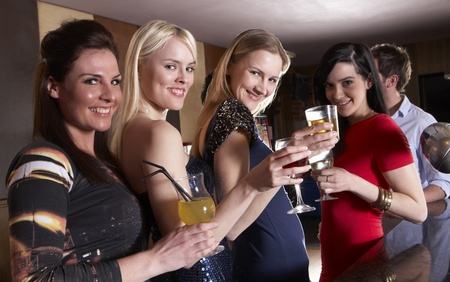 club dress: Young women posing at party