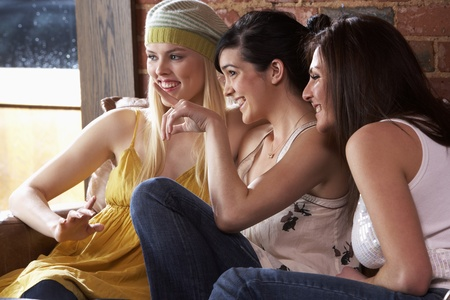Young women sitting together and talking Stock Photo - 10362607