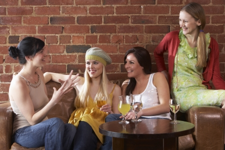 women having fun: Young women sitting together and talking Stock Photo