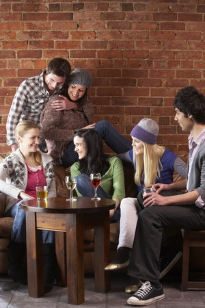 people having fun: Young friends in café Stock Photo