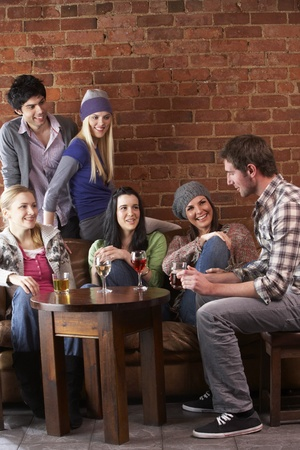 vertical bar: Young friends in café Stock Photo