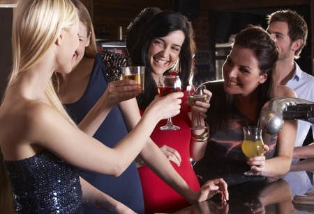 horizontal bar: Young women drinking at bar