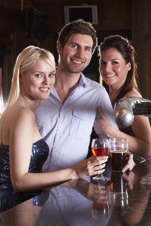 Friends having a drink in bar photo