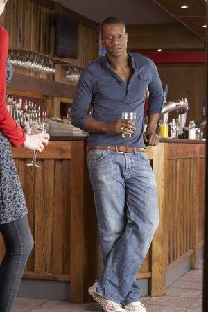 Handsome man in bar photo