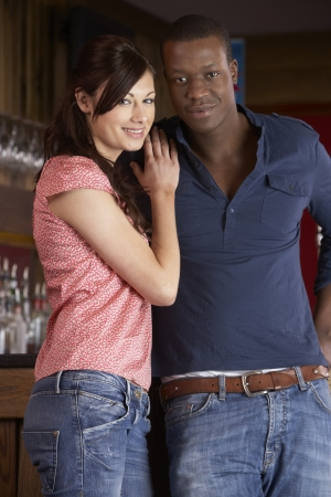 interracial relationships: Happy young couple in love