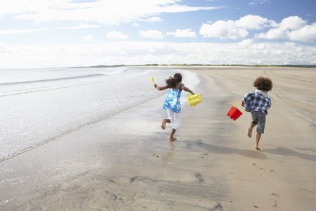5 10 years old: Children playing on beach Stock Photo