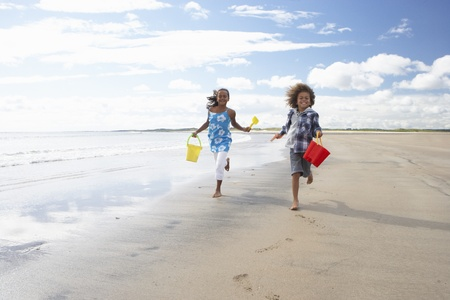discovering: Children playing on beach Stock Photo