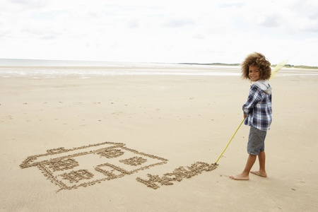summer house: Boy drawing in sand Stock Photo