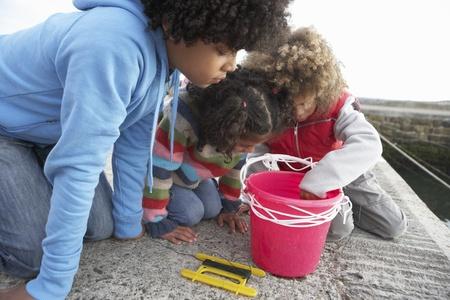 Children fishing for crabs Stock Photo