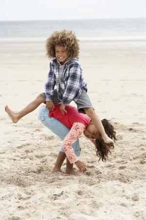 hopping: Happy children playing on beach