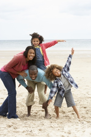 activity: Happy family playing on beach