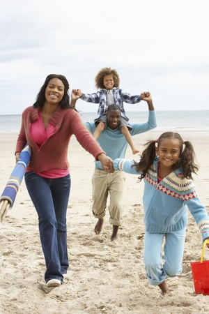family activities: Happy family running on beach