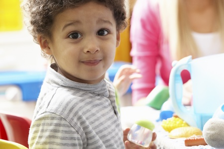 discovering: Boy playing with toys in nursery