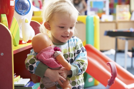 discovering: Young girl playing with toys