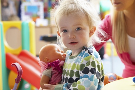 nursery school: Young girl playing with toys