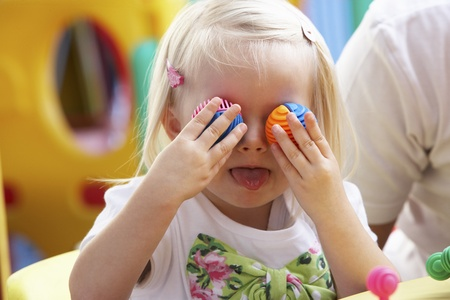 Young girl playing with toys Stock Photo - 10362613
