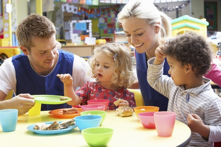 nursery: Couple and children playing with toys