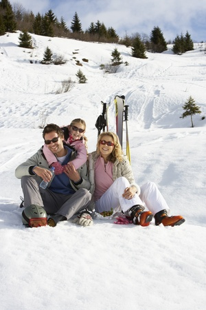 Young Family On Ski Vacation photo