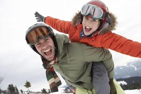 boy 12 year old: Young Father And Son On Winter Vacation Stock Photo