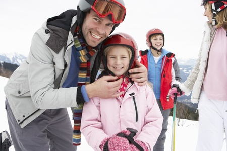 7 year old girl: Young Family On Ski Vacation