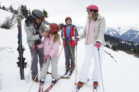 ski goggles: Young Family On Ski Vacation
