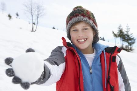 snowballs: Pre-teen Boy On Winter Vacation
