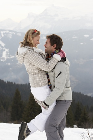 man woman hugging: Young Couple On Winter Vacation