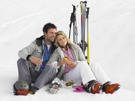 Young Couple With Picnic On Ski Vacation photo