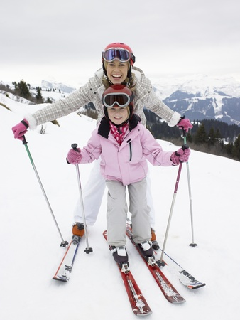 Young Mother And Daughter On Ski Vacation photo