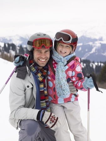 Young Father And Daughter On Ski Vacation Stock Photo