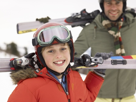 boy 12 year old: Pre-teen Boy With Father On Ski Vacation