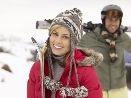 ski goggles: Young Couple On Ski Vacation