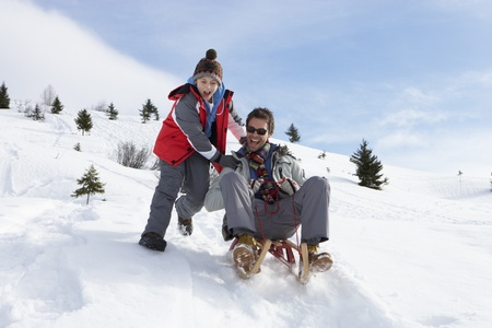 boy 12 year old: Young Father And Son Sledding