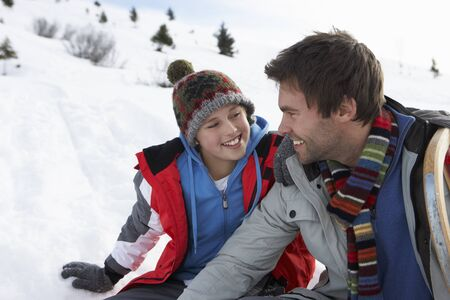Young Father And Son In Snowy Landscape photo