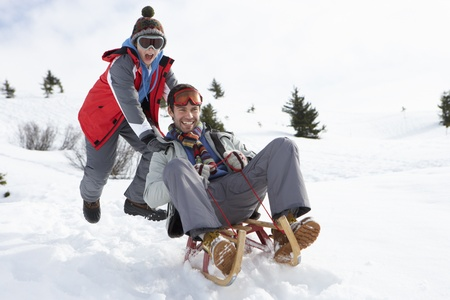 sledging people: Young Father And Son Sledding
