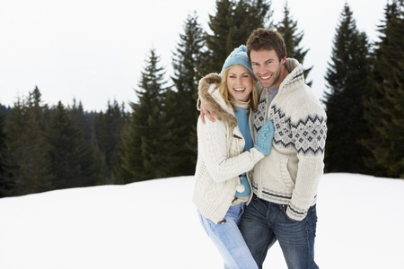 winter couple: Young Couple In Alpine Snow Scene