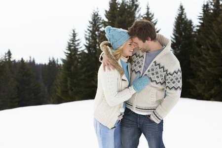 winter woman: Young Couple In Alpine Snow Scene
