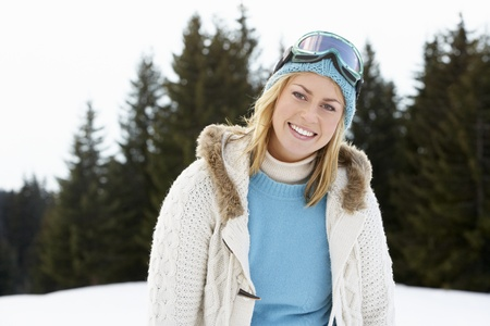 Young Woman  In Alpine Snow Scene photo