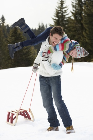 Young Father And Daughter In Snow With Sled photo
