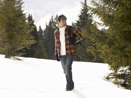 Young Man In Alpine Snow Scene photo