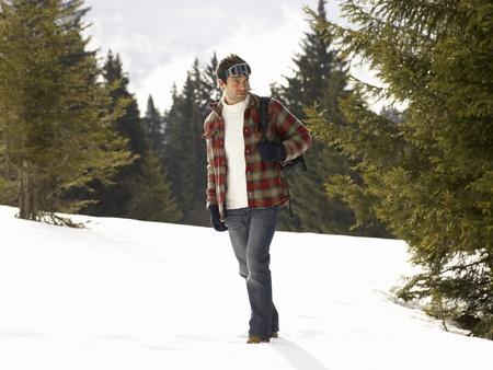 ski walking: Young Man In Alpine Snow Scene Stock Photo