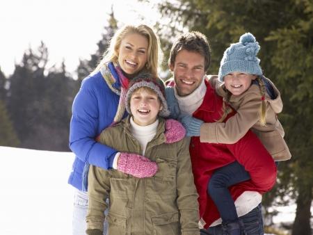 winter couple: Young Family  In Alpine Snow Scene