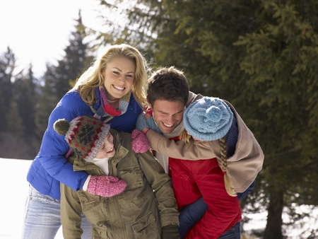 boy 12 year old: Young Family  In Alpine Snow Scene