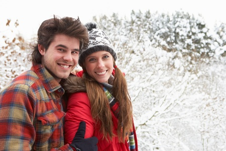 Young couple in snow photo
